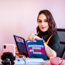 woman reading money making business book at desk